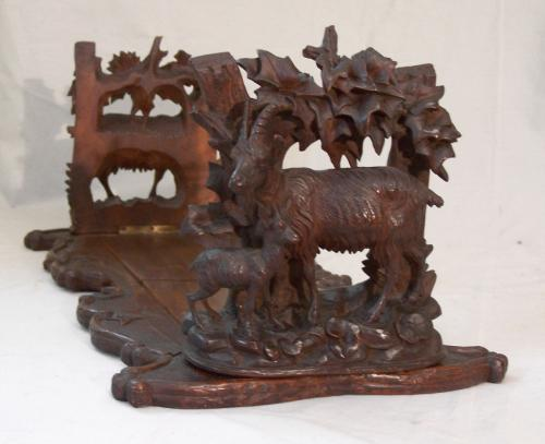 Black Forest carved walnut adjustable book ends c1880