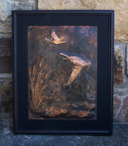 American copper relief of geese in a marsh c1900