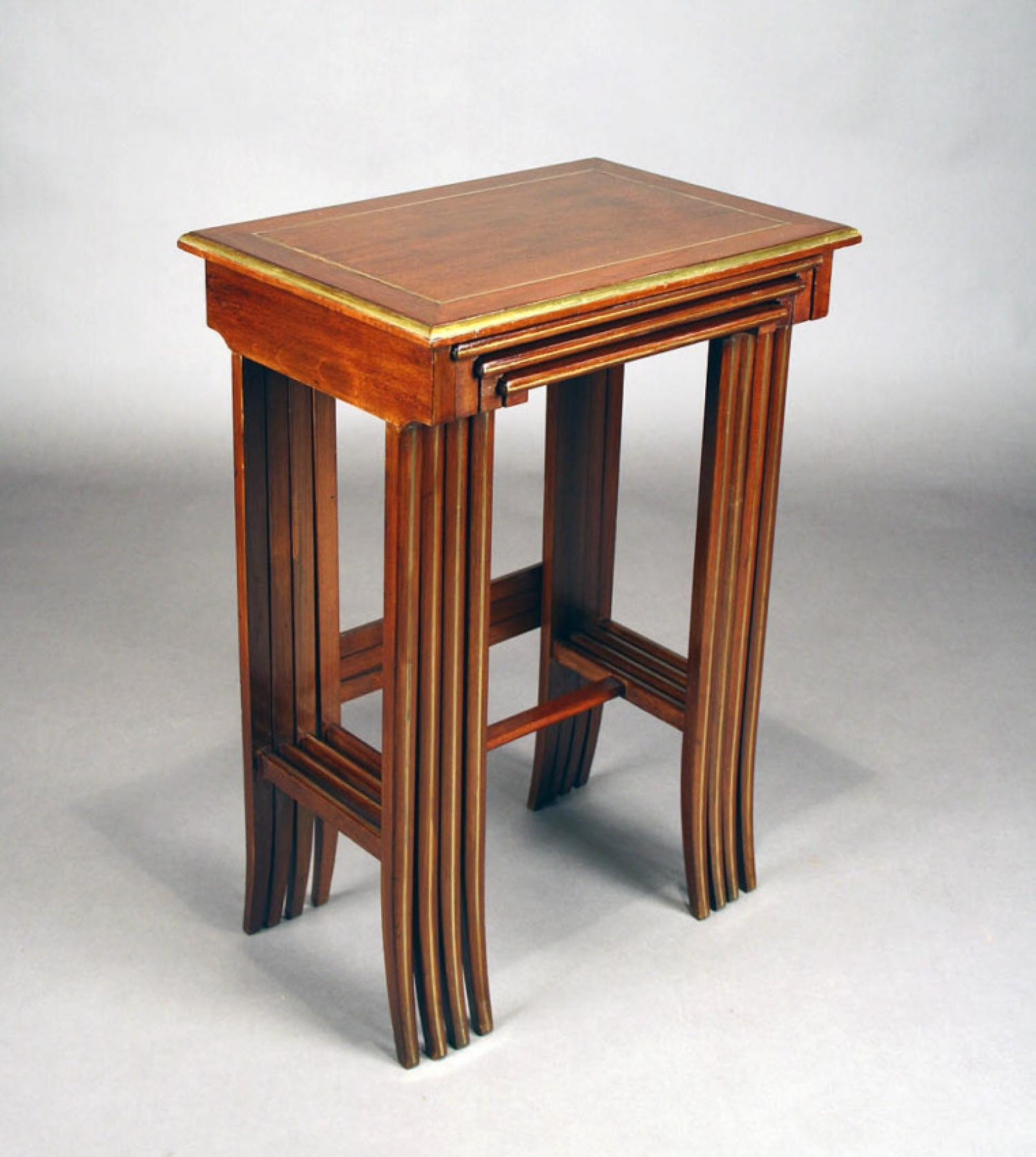 French set of four mahogany brass inlaid nesting tables c1910