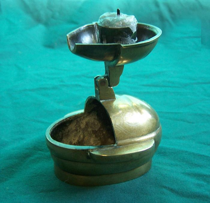 Early antique Chinese bronze travel candle stick with silver inlay