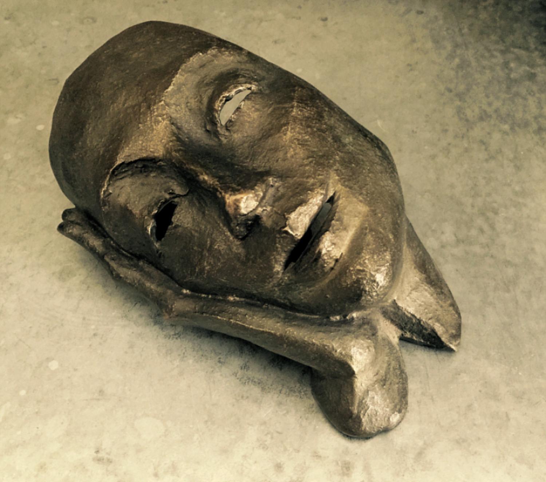 Modern bronze sculpture of a woman at rest