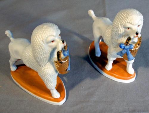 PR Continental blanc de chine porcelain poodle figures on plinths