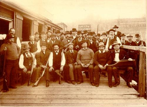 Photograph of hunting club with shot guns