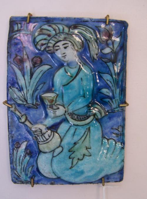 Early to mid 19thc Persian tile man with cup and ewer