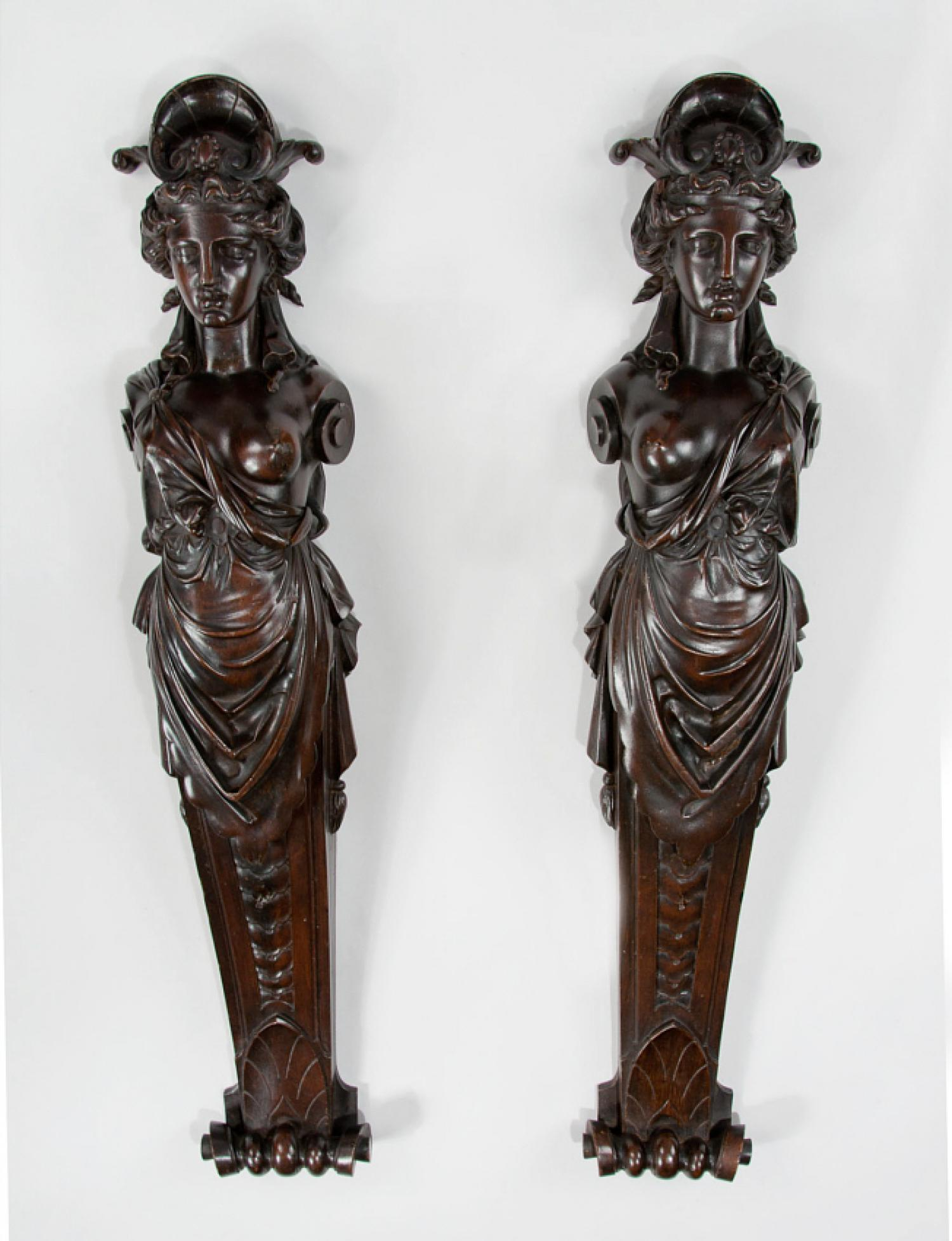 Finely carved pair of 19th century female architectural caryatids