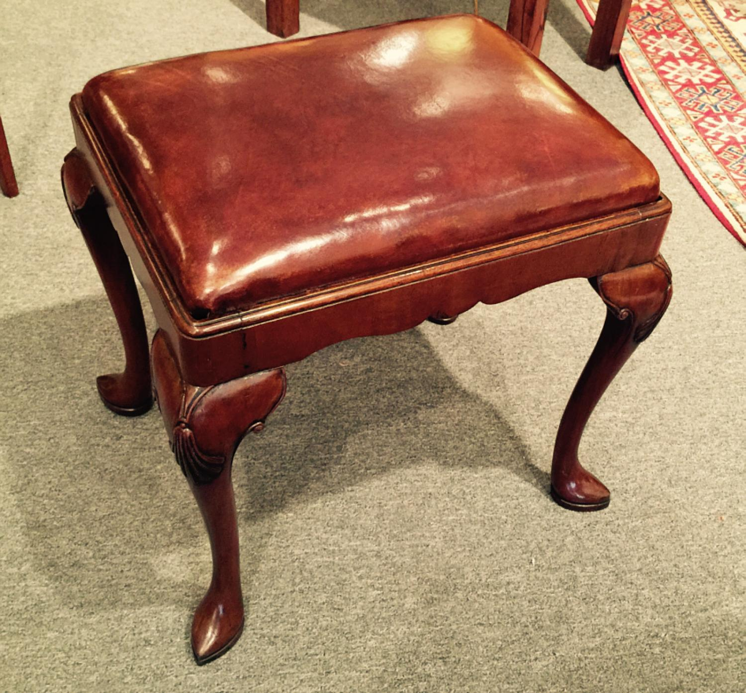 Antique walnut cabriole leg leather stool