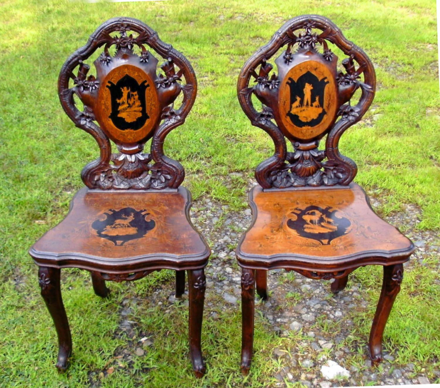 Antique pair of Black Forest carved hall chairs c1885