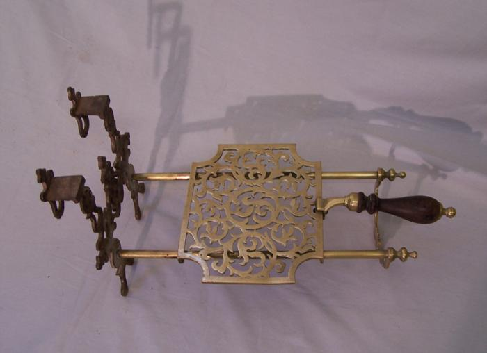 Antique English sliding brass fireplace trivet with hearts