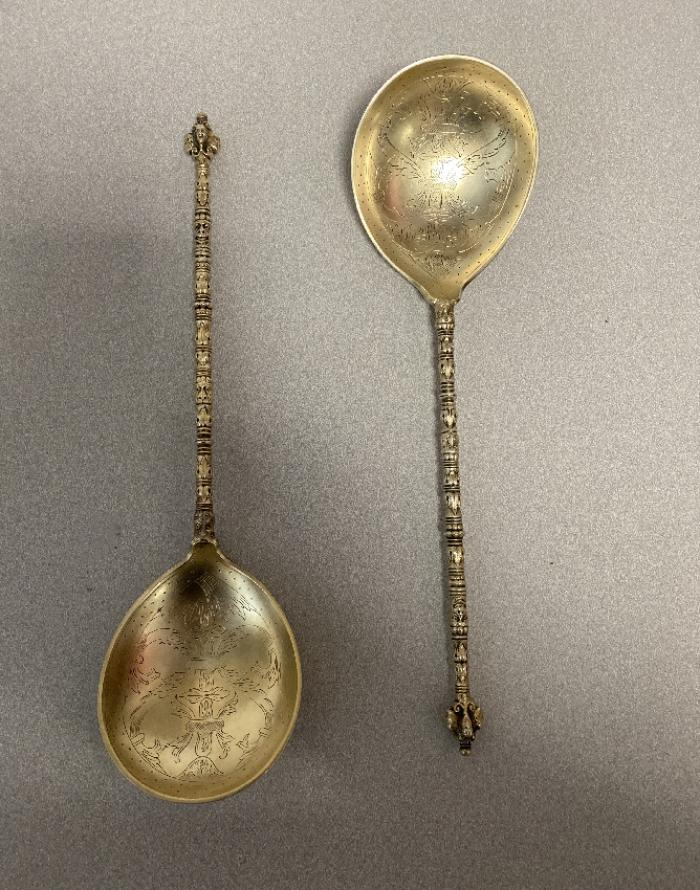 Pair Marius Hammer 830 silver and gold spoons
