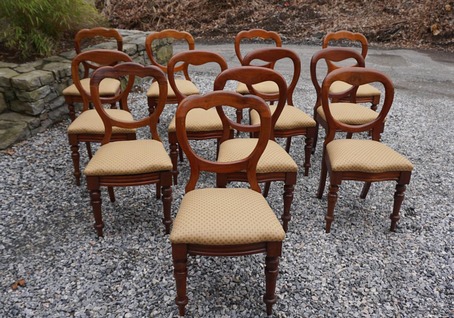 Set of 12 English early Victorian campaign chairs