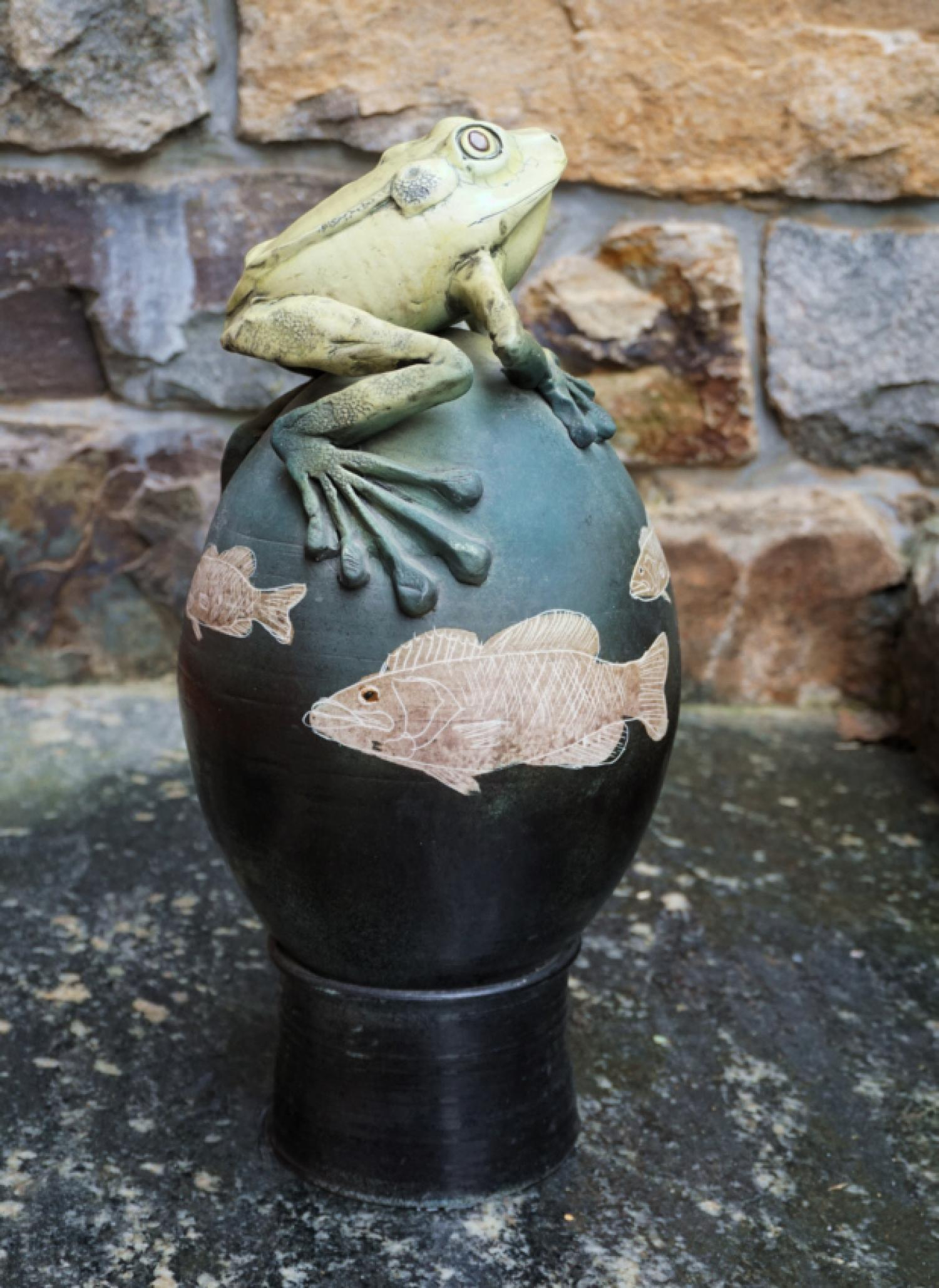 Artisan ceramic frog and fish garden sculpture