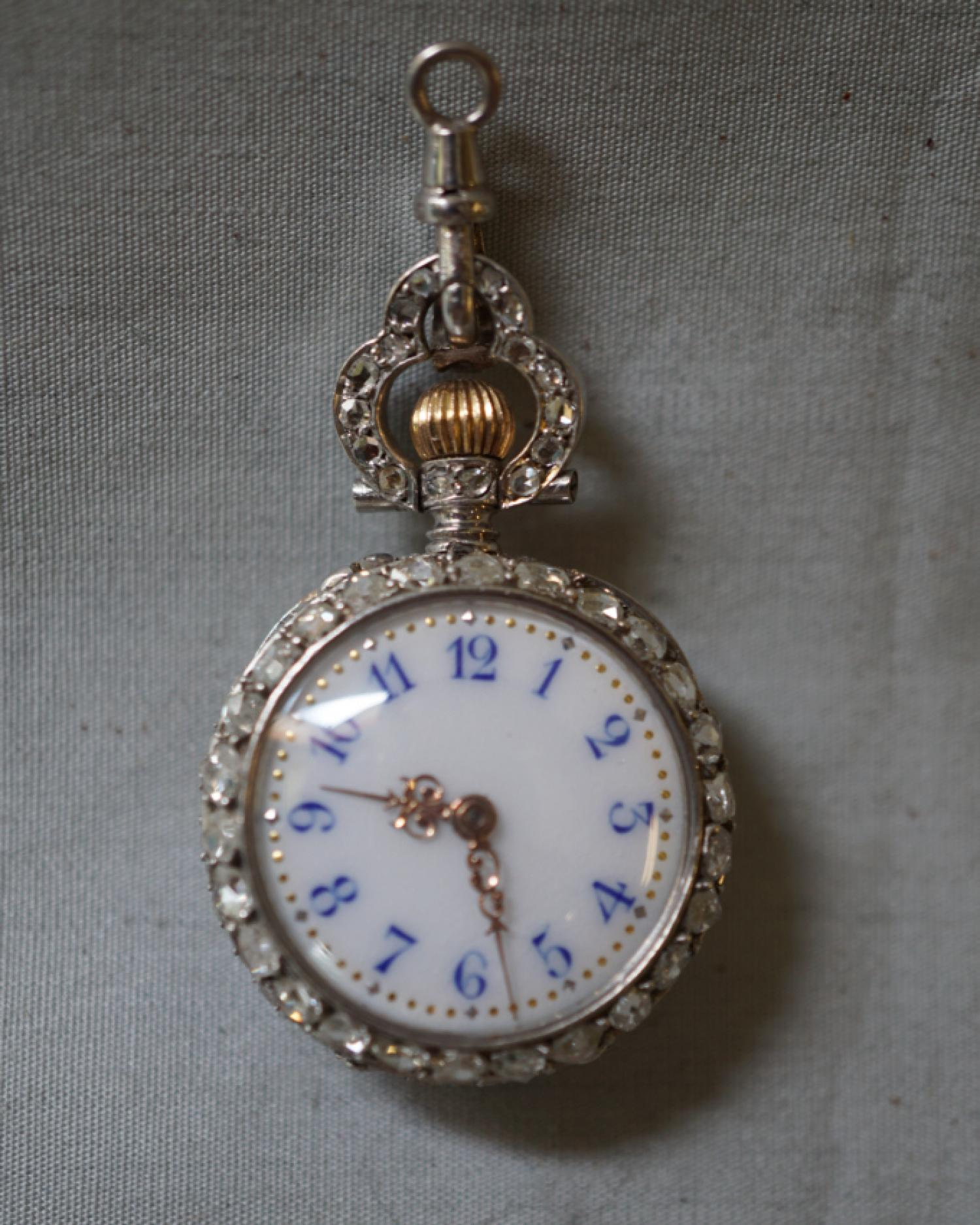 Antique silver and diamond pendant watch