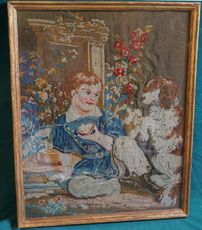 Antique needlepoint tapestry of a boy and his dog