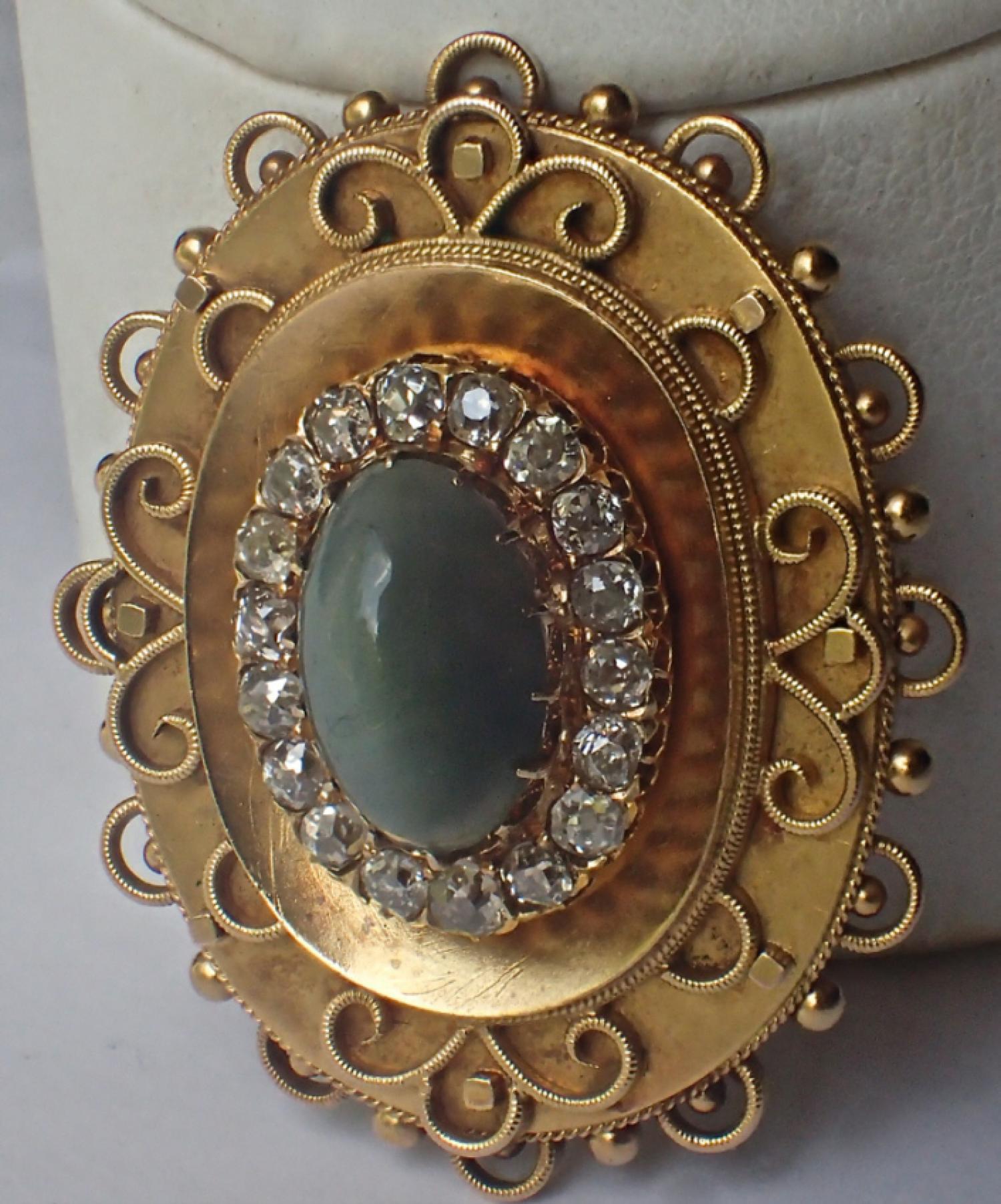 Victorian 18K green chrysoberyl cats eye diamond brooch