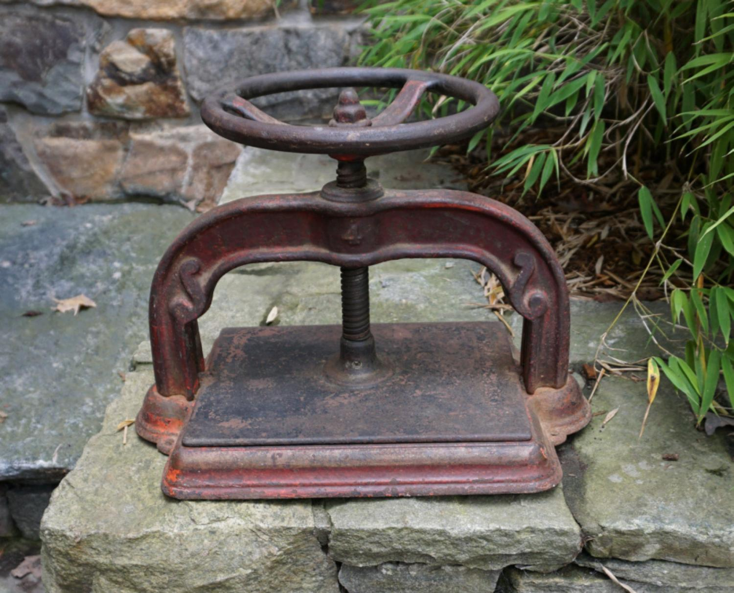 Antique iron book press in original red paint