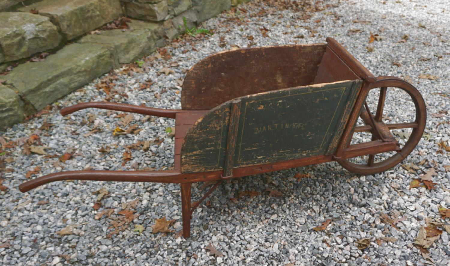 Antique wheelbarrow in original red and green paint