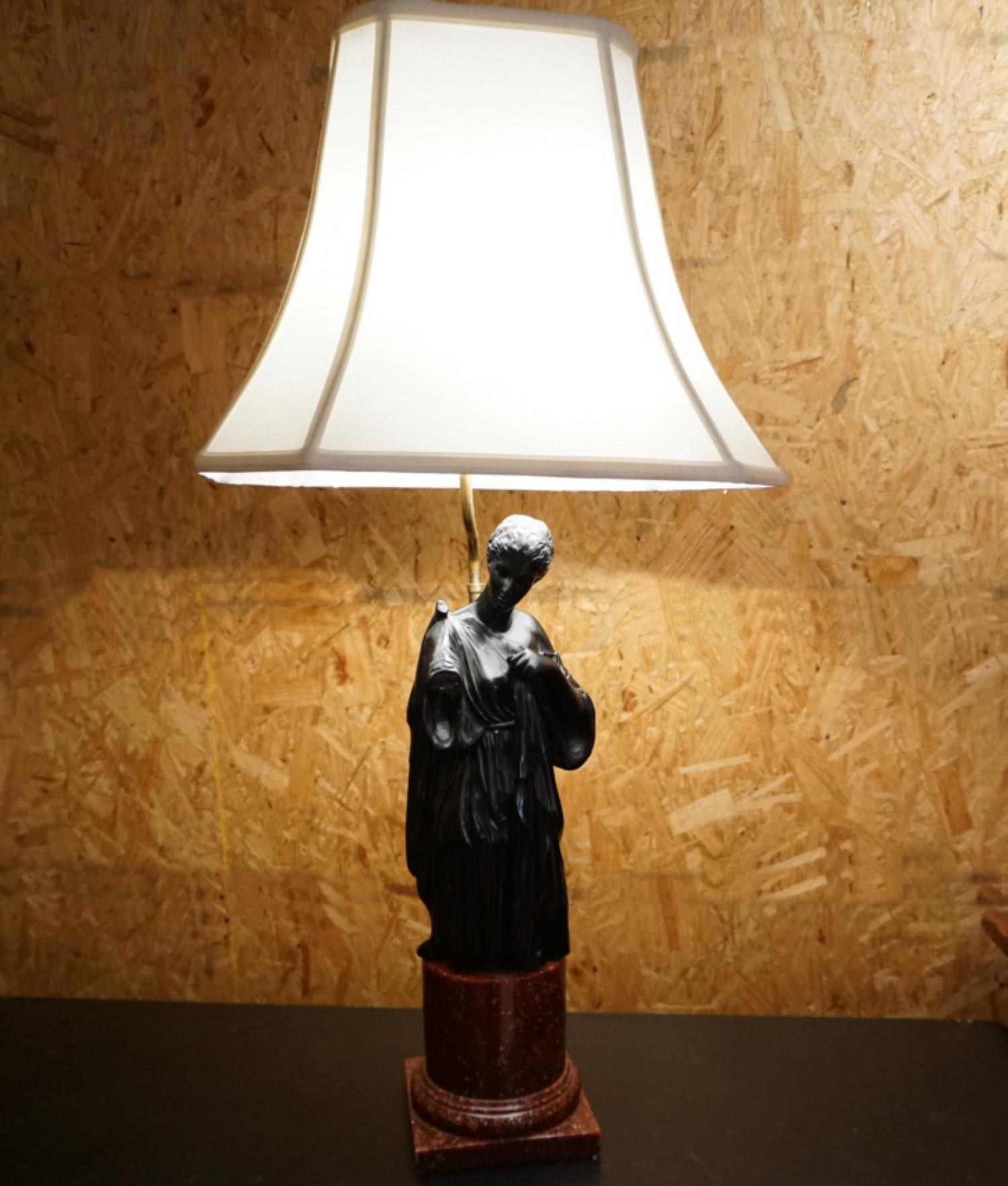 Neoclassical lamp with black basalt figure on red porphyry base c1970