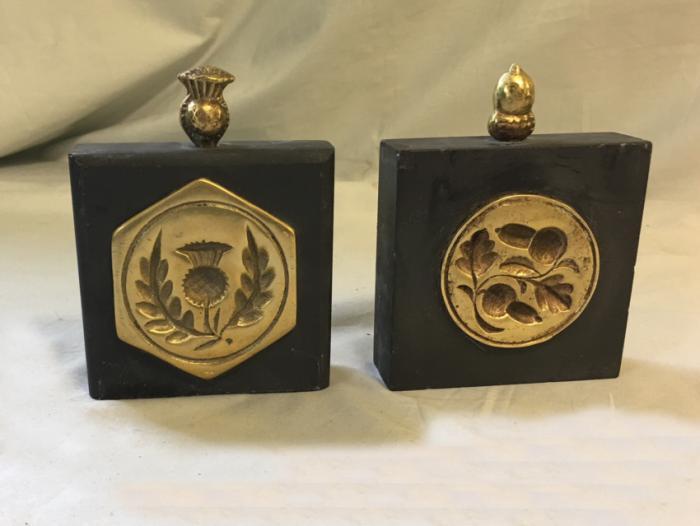 Antique British brass butter mold bookends