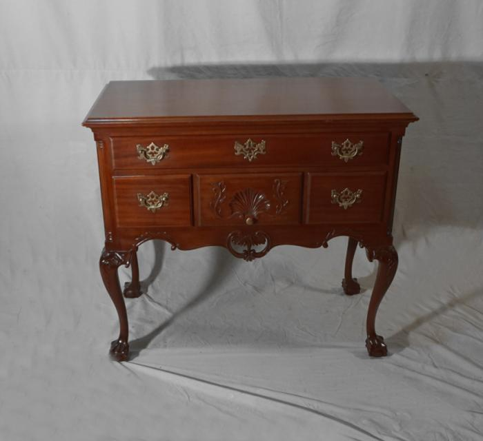 Vintage mahogany lowboy with claw feet