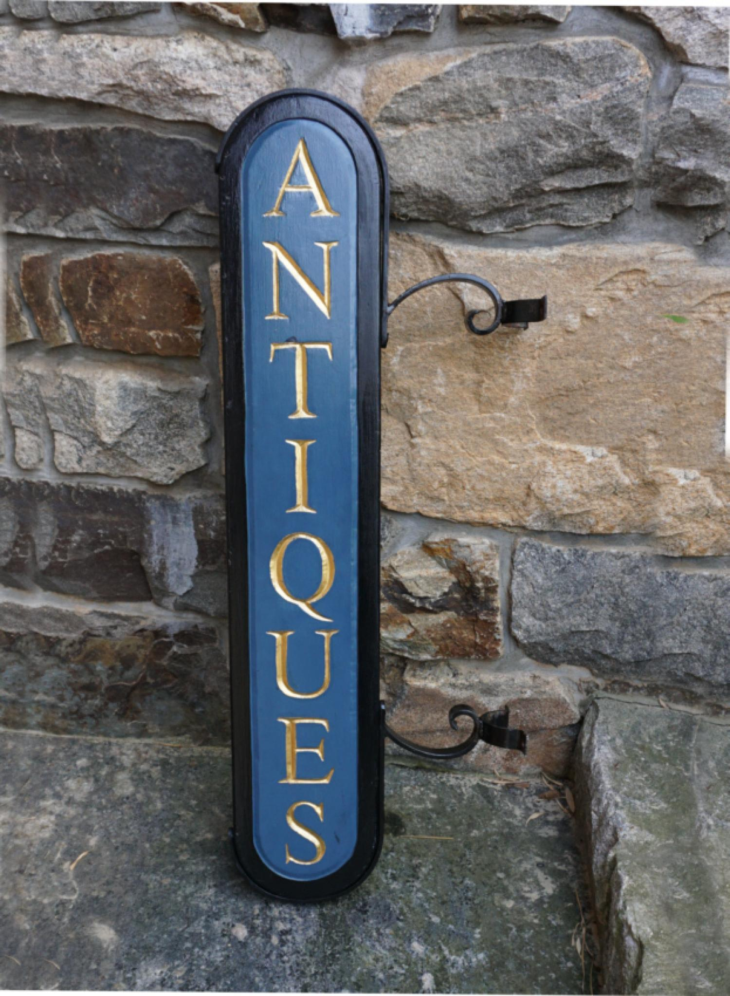 Hand carved antiques shop sign