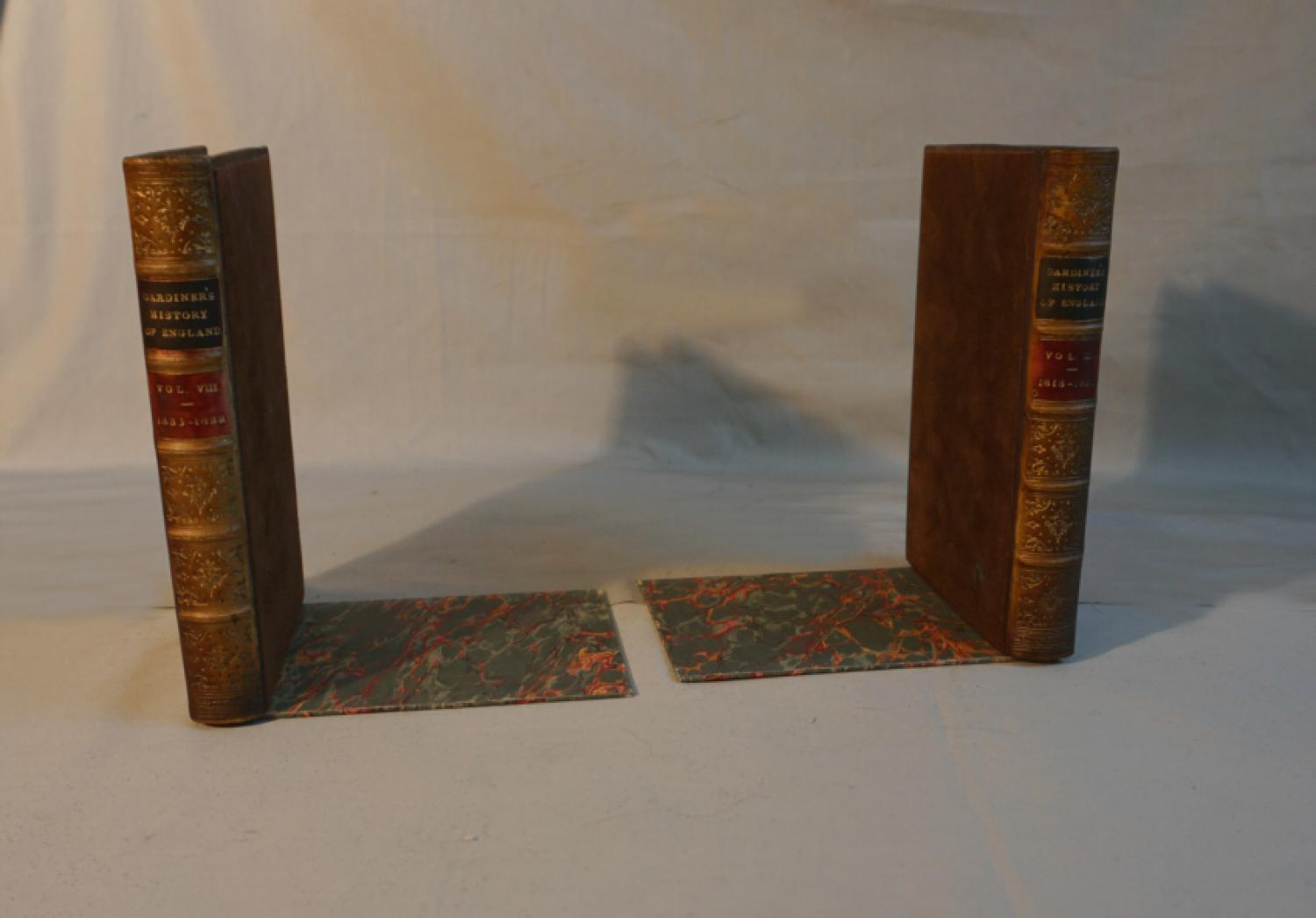 Antique pair of faux painted bookends