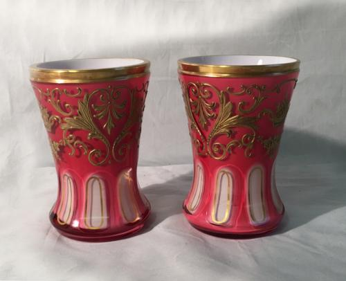 Antique Bohemian pink and gilt cut glass vases