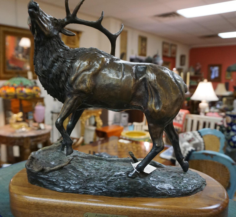Cast bronze sculpture of an elk by Roy Harris
