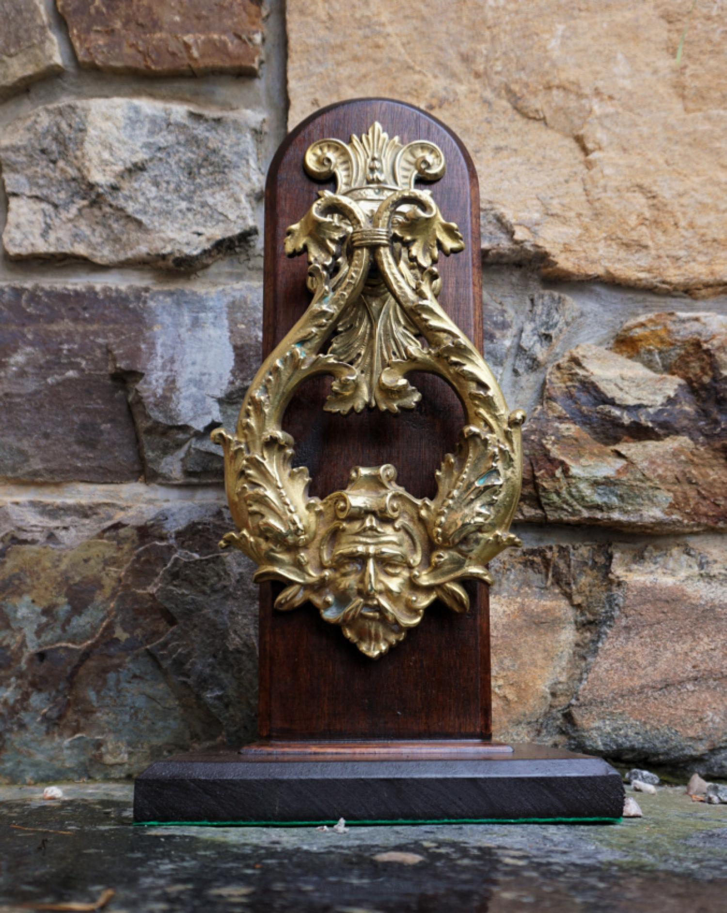 Large antique English brass door knocker with dolphins and figures