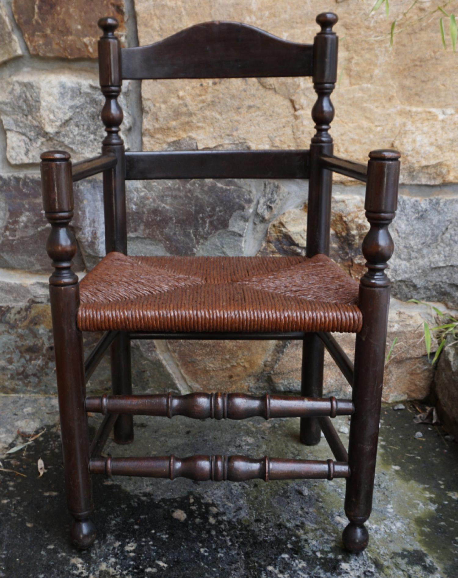 Antique child size ladder back arm chair c1900