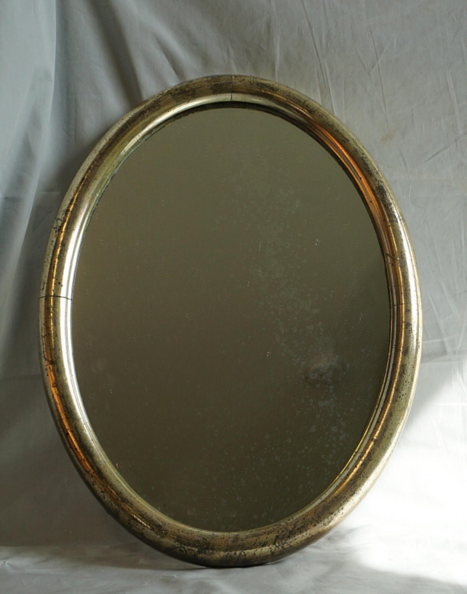 Antique oval mirror in original silver leaf c1870