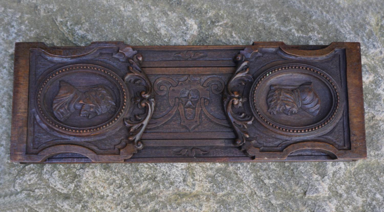 Carved walnut adjustable book holder c1900