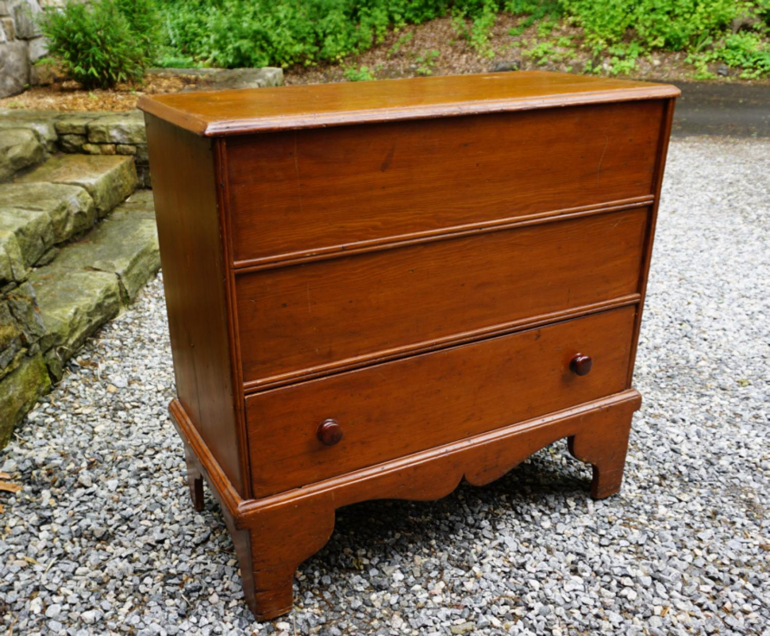 Early American pine lift top blanket chest with boot jack ends c1740