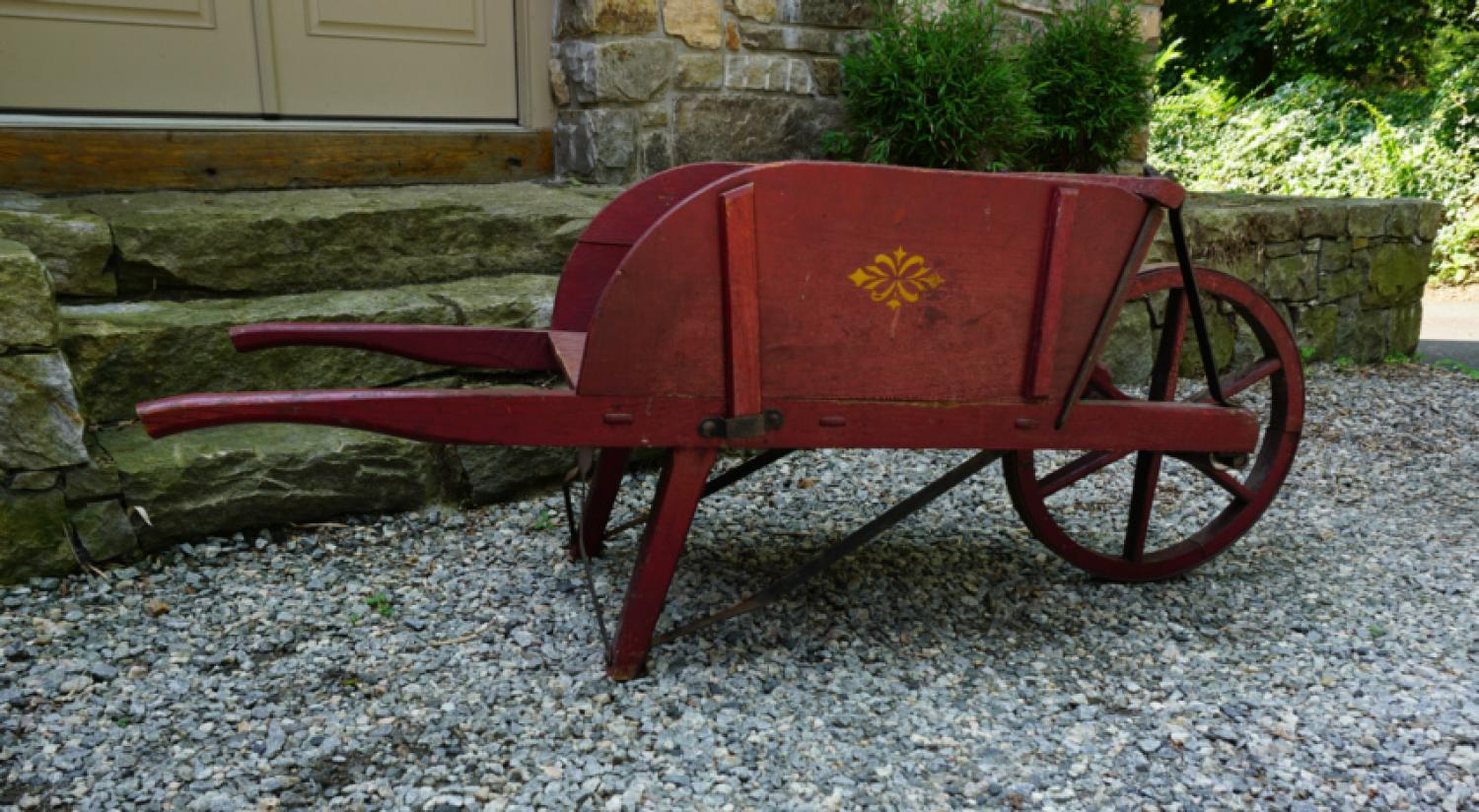 Antique wheelbarrow in original red paint c1900