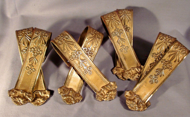 Four pairs of French ormolu tiebacks