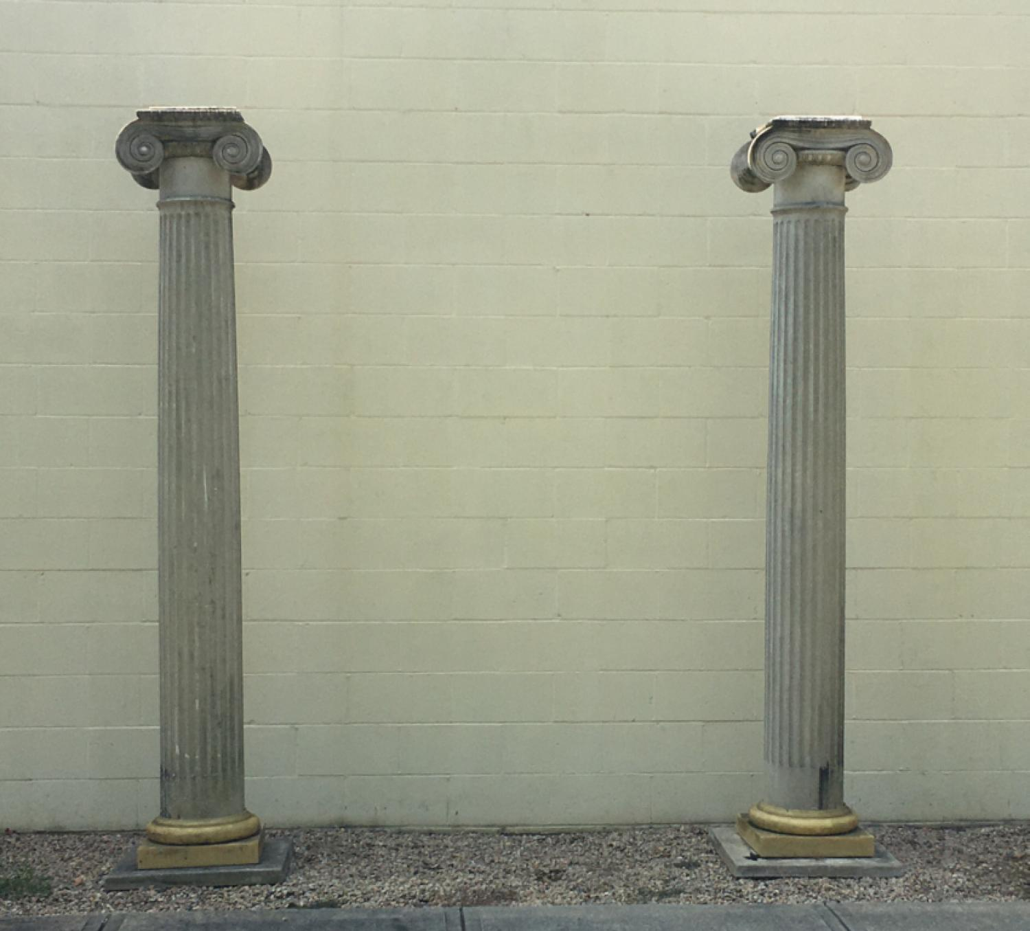 Pair of large Doric style architectural fluted columns