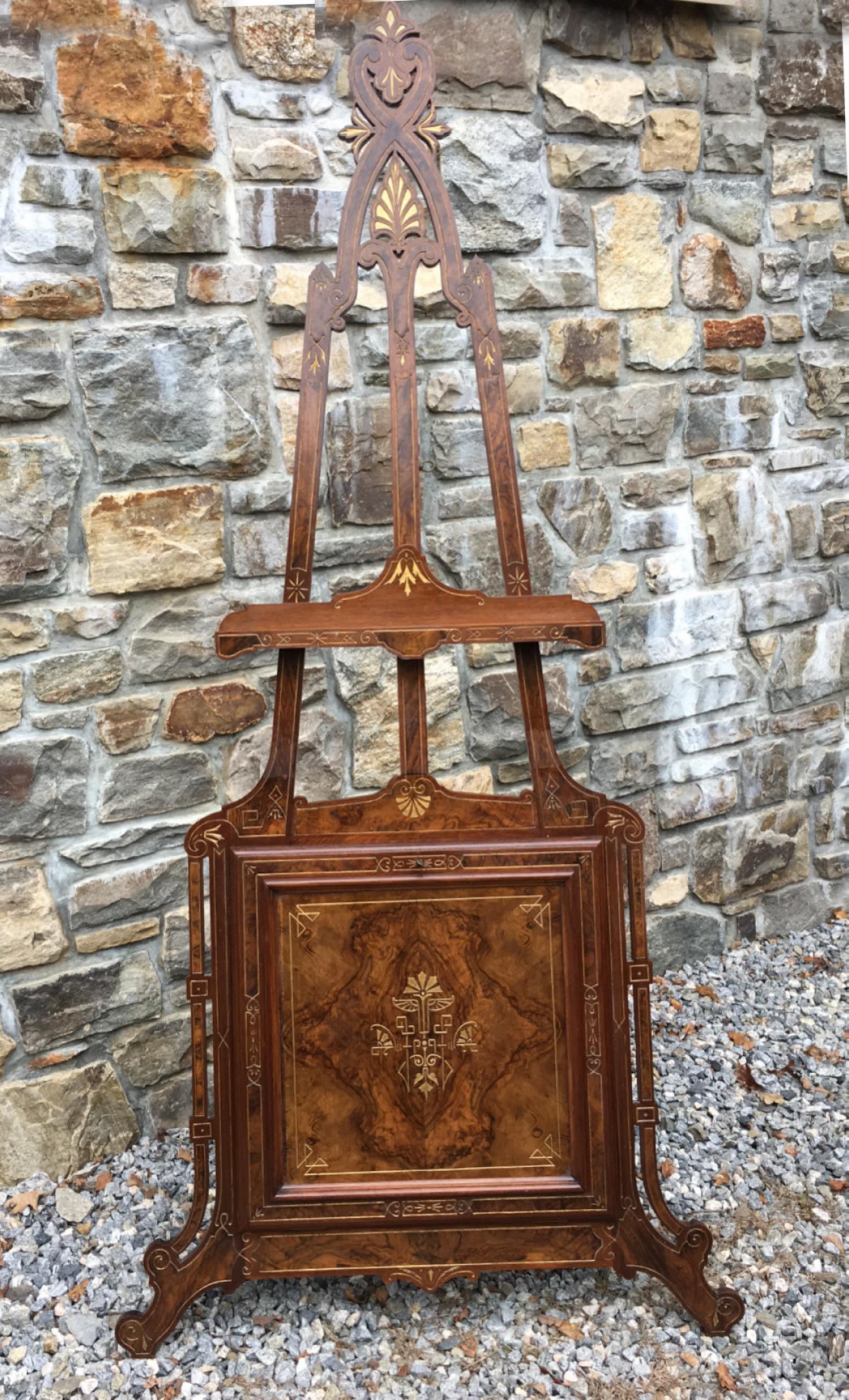 Antique walnut display easel in the aesthetic taste